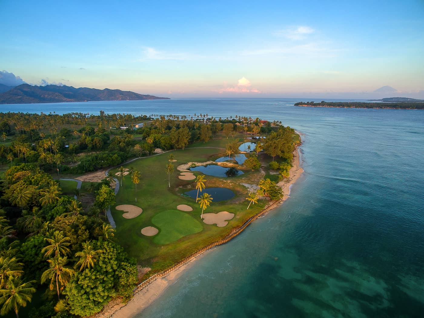 aerial sunrise villa golf course photo Lombok