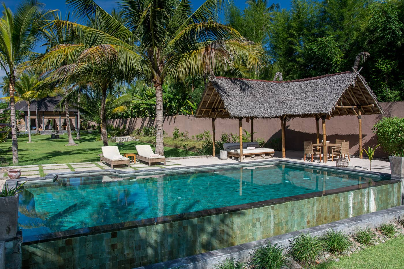 exterior pool and garden image of The Beach Villa Lombok