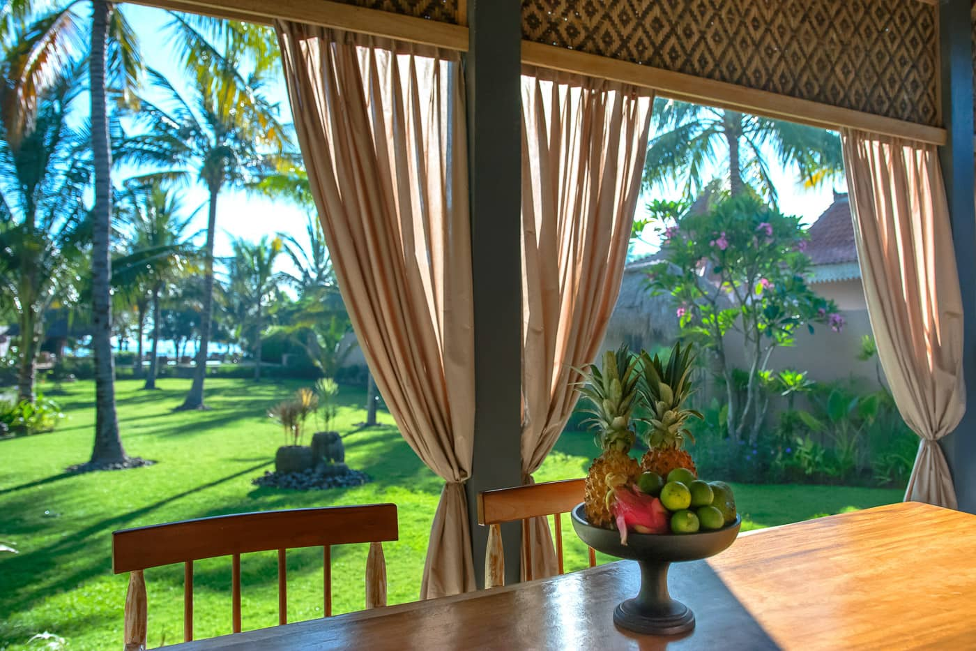 interior dining area with background gardens, pool and beach image of The Beach Villa Lombok